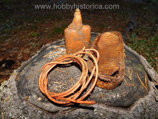 Pioneer wire, fish tin and losantine bottle.